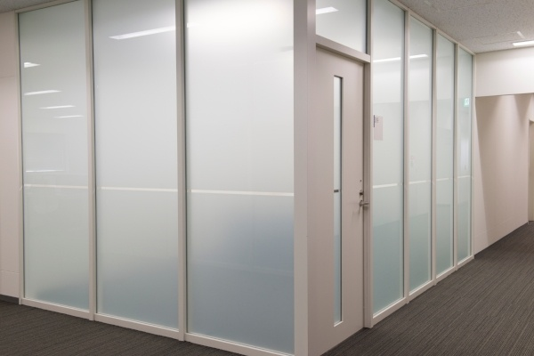 Dynamic glass Vision Control Film in an office setting.